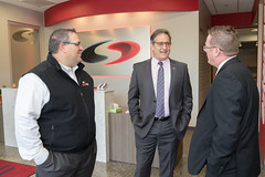 State Representative John Fusco speaks with employees from Southington's SignPro during a business tour and announcement that the facility is 100% solar powered.