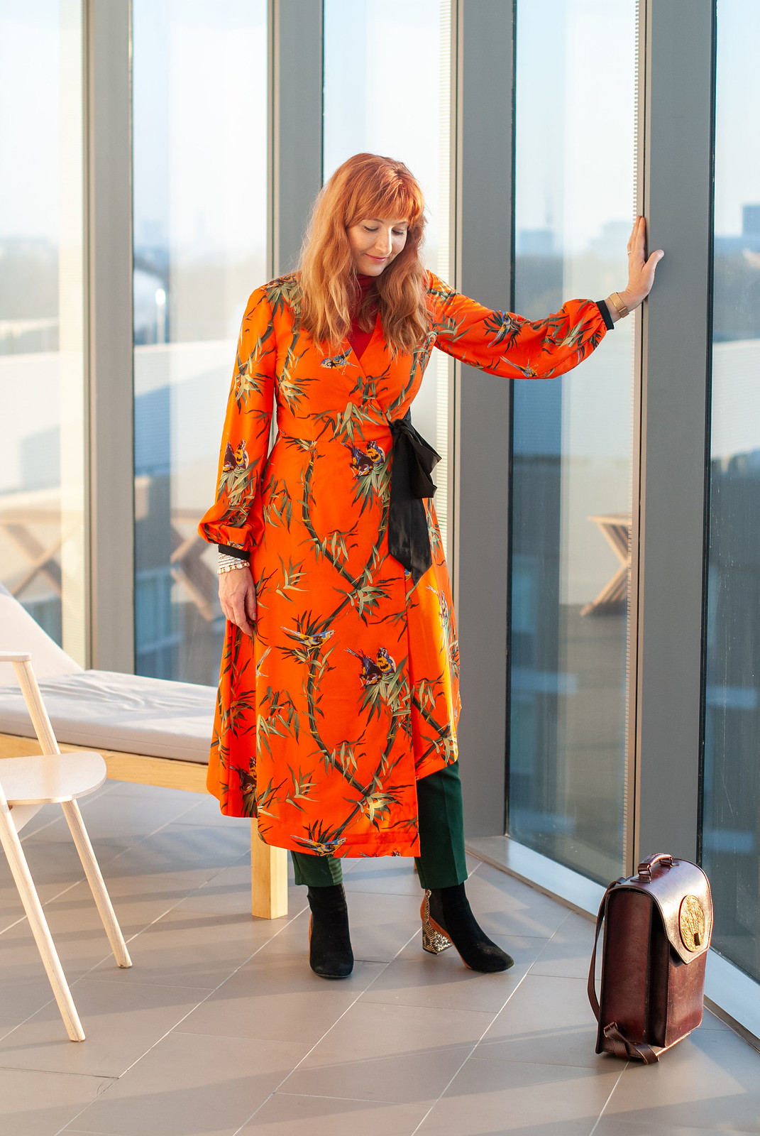 Layering a Midi Dress and Trousers Under a Tailored Coat \ orange floral midi dress \ navy pinstripe tailored coat \ emerald green trousers \ snakeskin and suede ankle boots \ Beara Beara leather backpack | Not Dressed As Lamb, over 40 style