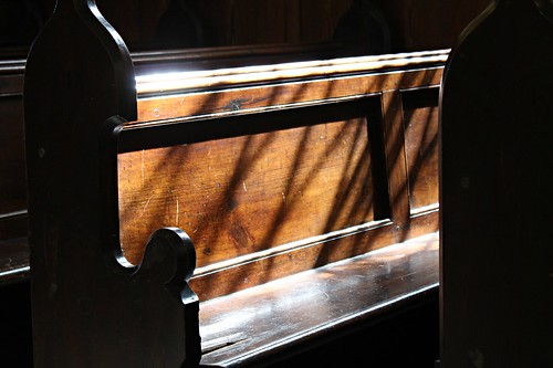 Sun shining in on one of the pews in the Ardcroney Church