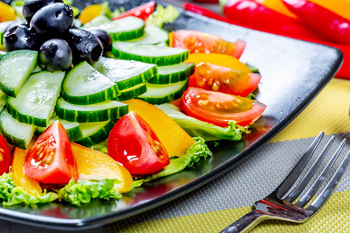 Salad with tomato pepper and cucumber, food close up | by wuestenigel