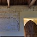 021-20180927_Little Washbourne Church-Gloucestershire-Nave, S side-section of wall with plaster removed to reveal stonework & medieval decoration