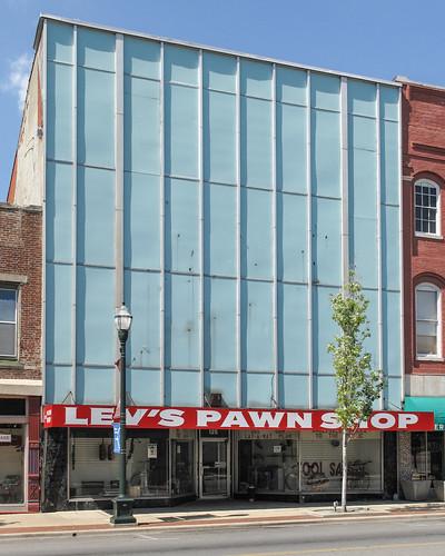 A light blue 3-story pawnshop.