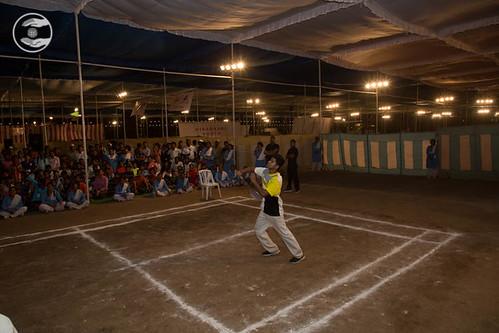 Devotee playing Badminton