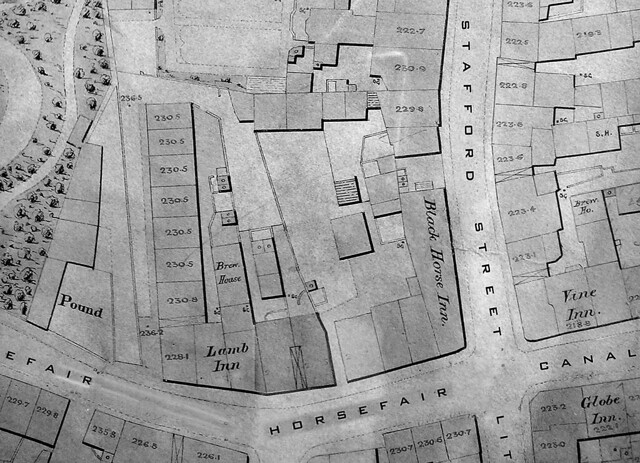 """Map of the junction of Horsefair, Stafford Street, Canal Street and Little Berry Street 1875. Showing the """"Vine"""" Inn and the """"Globe"""" Inn at the top of Canal Street, and the Black Horse Inn at the top of Stafford Street."""