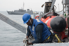 Mineman 3rd Class Latron Jolly removes safety lines to launch a mine neutralization vehicle from USS Chief (MCM 14), Nov. 26. (U.S. Navy/MC2 Jordan Crouch)