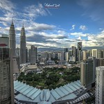 Rainbow at noon in Kuala Lumpur City Center with beautiful clouds formation