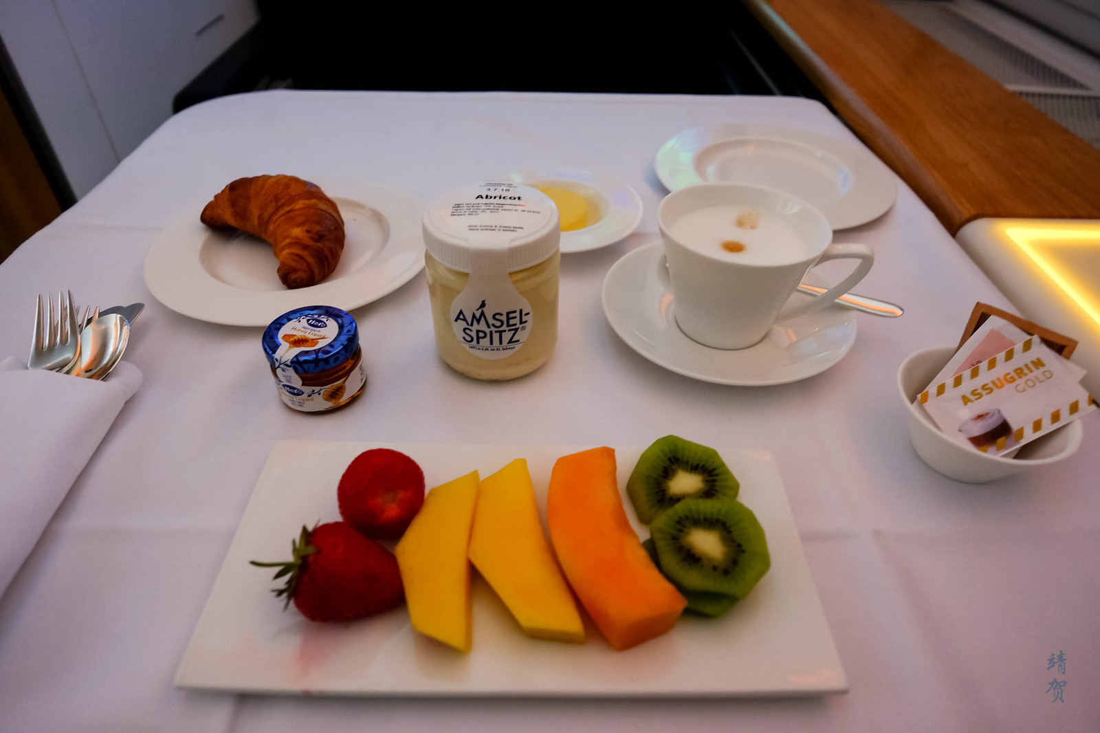 Fruit plate, yogurt and croissant
