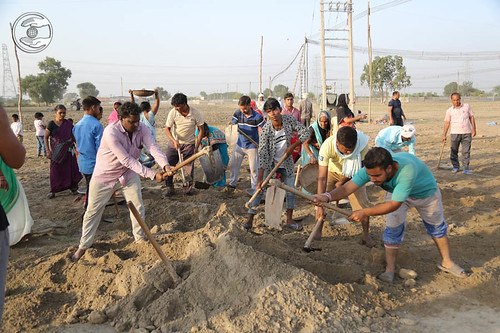 Devotees leveling the ground