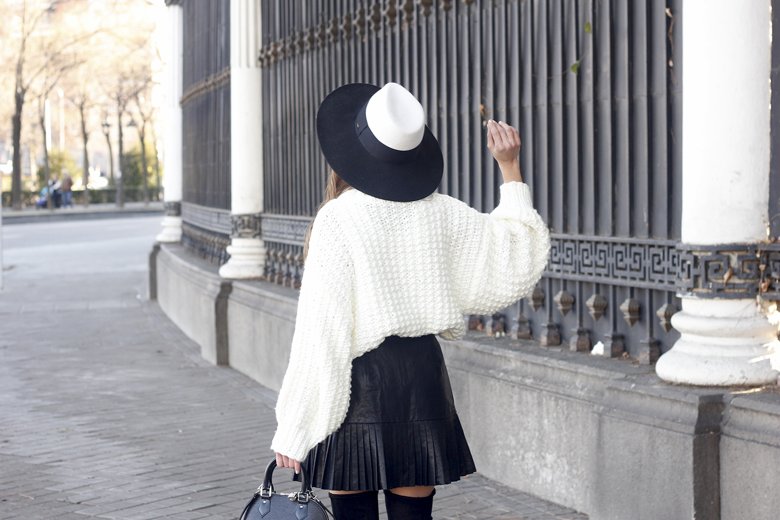 black pleated skirt  white sweater louis vuitton bag street style inspiration 201911
