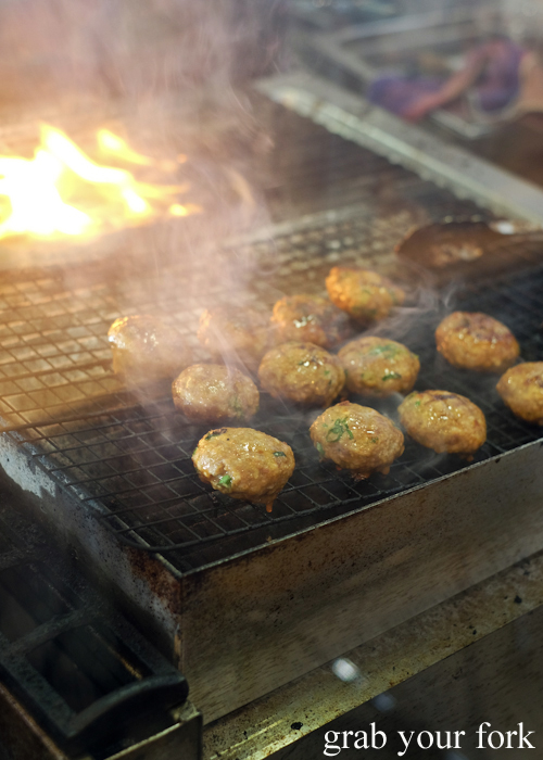 Grilling pork meatballs for bun cha at Mam Mam Vietnamese restaurant in Bankstown
