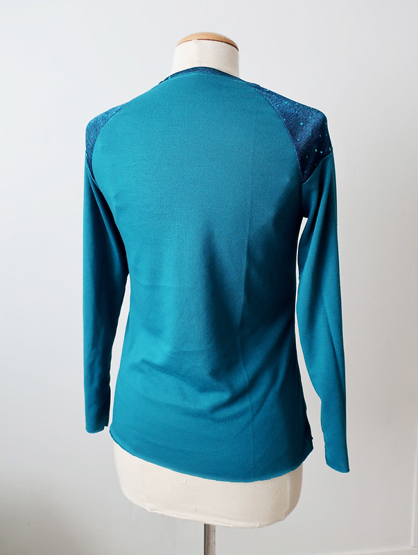 Teal knit top back view