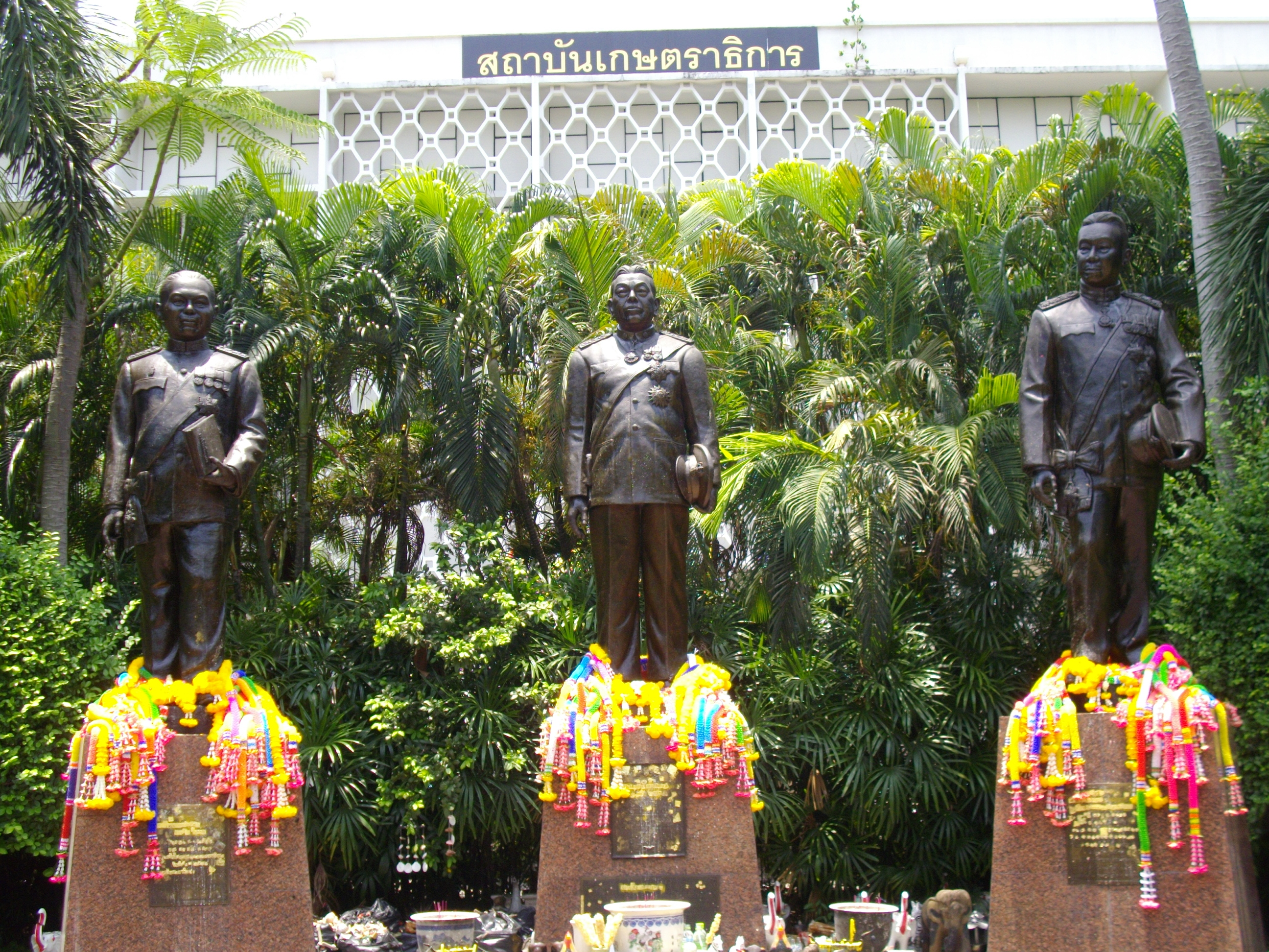 Monuments of the Three Masters of Kasetsart University, from left, Phra Chuangkasetsilapakan (พระช่วงเกษตรศิลปการ), Luang Suvarnavachakakasikij (หลวงสุวรรณวาจกกสิกิจ), Luang Ingasrikasikan (หลวงอิงคศรีกสิการ). These statues are situated in front of Kasetrathikarn Institute, inside Kasetsart University, Bangkok, Thailand. Photo taken on April 24, 2009.