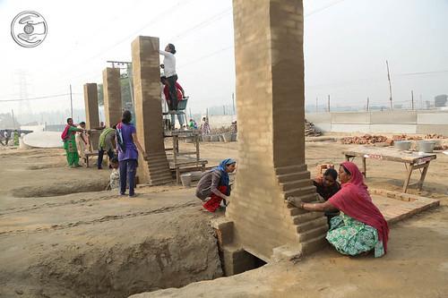 Devotees putting Langar