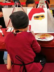Kinder malen den Weihnachtsmann