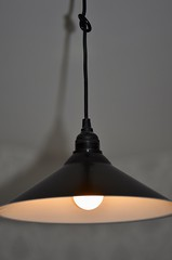 Black pendant lamp hanging on wire