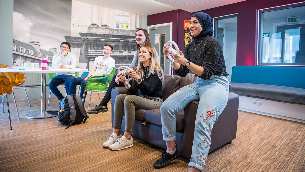 Students socialise together in the accommodation on campus