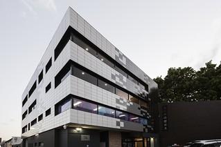 PROJ - Apex Apartments featuring TN Glazed in Brilliant White, Grey and Black