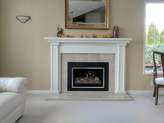 Kozy Heat Chaska 29G w/rocks and Brushed Nickel front. | by Thompson's Hearth & Home