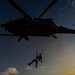 A U.S. Air Force pararescueman is lowered from a U.S. Air Force HH-60 Pave Hawk during a mission Nov. 7, 2012, in Afghanistan. Pararescue teams assault, secure, and dominate the rescue objective area using any available Department of Defense or allied, air, land, or sea asset. (U.S. Air Force photo/Staff Sgt. Jonathan Snyder)