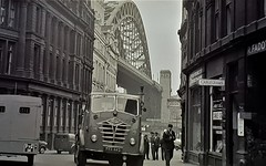 ManOfYorkshire posted a photo:	A Foden lorry makes its way up from the riverside into the City.As with most Towns and Cities across the North in the 50s 60s and early 70s the buildings are black as the stone has discoloured due to air conditions and the nature of the stone used.
