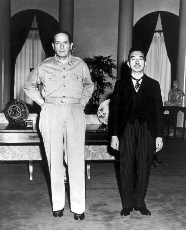 Japanese Emperor Hirohito and U.S. General Douglas MacArthur, at their first meeting, at the U.S. Embassy, Tokyo, September 27, 1945. Photo taken by U.S. Army photographer Lt. Gaetano Faillace.