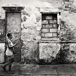Old Wall & Lady Cartagena Colombia Eric Cheek by Eric Cheek