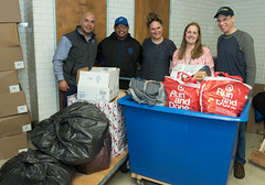Waterbury Police Sgt. Ryan Bessette, Waterbuy Police Officer Querino Maia, Rep. Cummings, Volunteers Judy Barnes and her husband Alex Oliphant posed with some of the bags of donated goods collected during a Veterans Holiday Giving Tree drive.