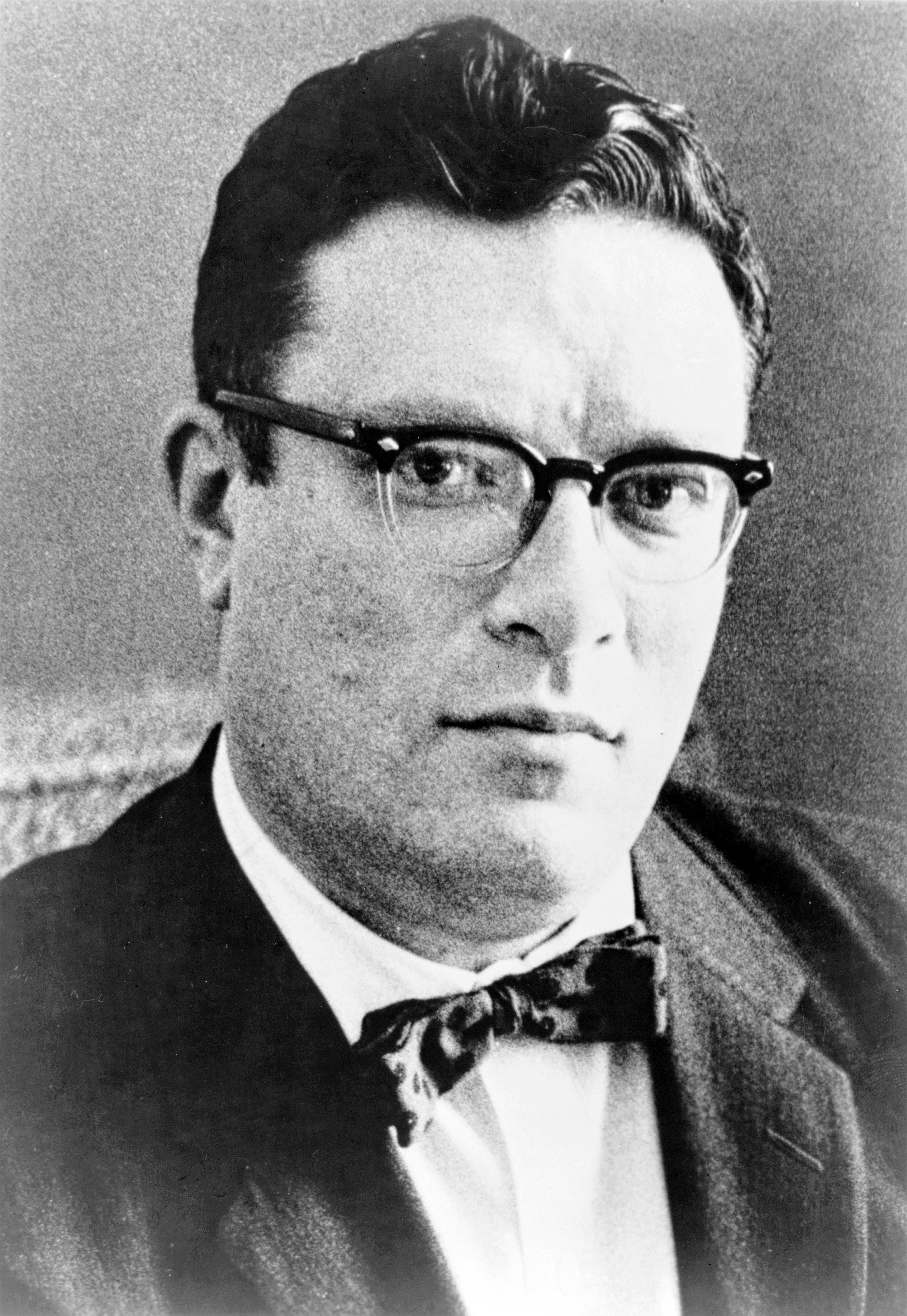 Dr. Isaac Asimov, head-and-shoulders portrait, facing slightly right. Published in 1965, this photo also appears on the jacket of the Doubleday first edition of Nine Tomorrows so date of creation can be no later than 1959.