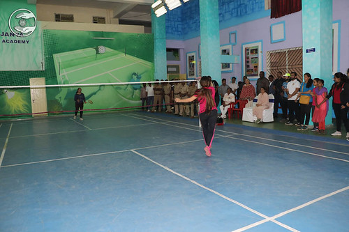 Devotees playing Badminton