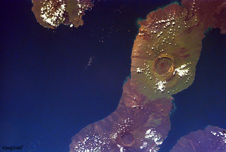 This image of the Galapagos Islands captures two large shield volcanoes on Isla Isabella. Original from NASA. Digitally enhanced by rawpixel.
