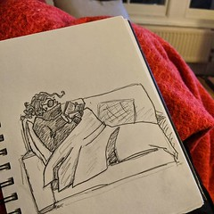 London looks sideways and thinks about getting cold... I'm already fighting the urge to hibernate. (Yes, the blanket in the sketch really is over my knees).