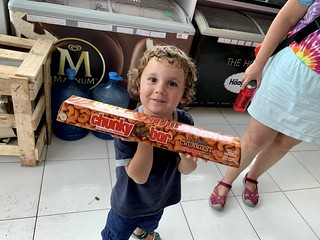 Sawyer is utterly and totally thrilled to discover this giant candy bar at a local warung