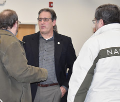 Rep. John Fusco talks with constituents after hosting a town hall meeting at the John Weichsel Municipal Center.