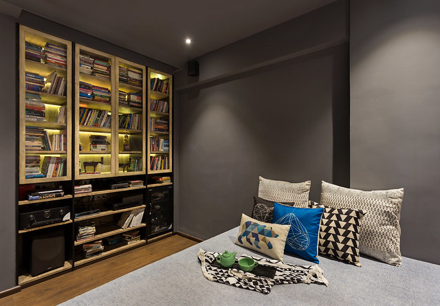 Media room with a large bed and book shelf