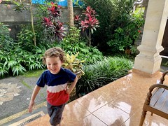 Sawyer laughs hard as he plays games with Madeleine in the villa courtyard