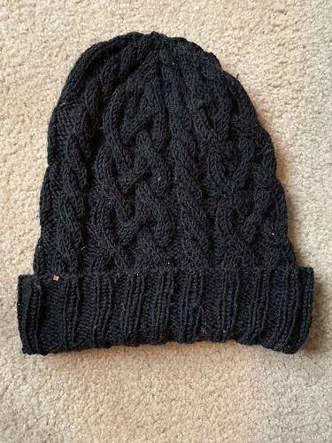 Lost and found black traveling cables hat