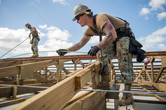 TINIAN, Northern Mariana Islands (Nov. 14, 2018) Builder 3rd Class William Mathis, from Ragland, Ala., and Builder 2nd Class Anthony DeSalvo, from Savona, N.Y., both assigned to Naval Mobile Construction Battalion 1, Detachment Guam, measure purlins on the roof of Tinian Elementary School during recovery efforts. Service members from Joint Region Marianas and U.S. Indo-Pacific Command are providing Department of Defense support to the Commonwealth of the Northern Mariana Islands' civil and local officials as part of the Federal Emergency Management Agency-supported Super Typhoon Yutu recovery efforts. (U.S. Navy photo by Mass Communication Specialist 2nd Class Kelsey J. Hockenberger)