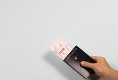 Flight Tickets Holding In Hand