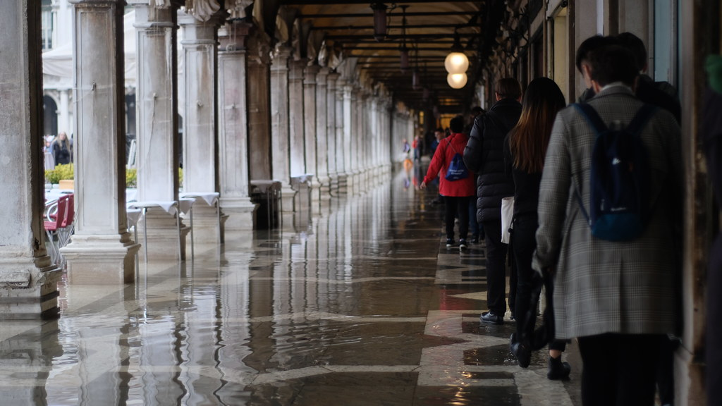 Cornell in Rome students lined up in order to avoid the water at Piazza San Marco in Venice, Italy.   photo / Maria Ford (B.Arch. '21)