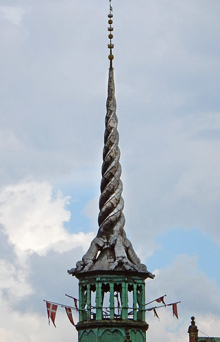 A building whose spiral steeple is made up of twisted dragon tails in Copenhagen, Denmark