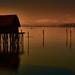 Stilt house in the setting sun
