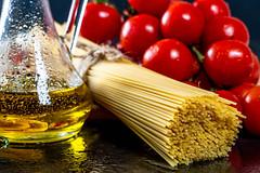 Olive oil, spaghetti and red chili pepper close-up