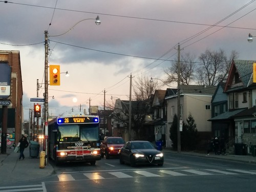 Looking east on Dupont (3) #toronto #dupontstreet #dovercourtvillage #dovercourtroad #intersection #sunset #clouds #moon