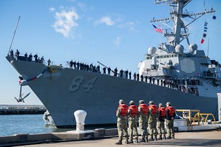 Sailors stand by as USS Bulkeley pulls into Naval Station Norfolk.