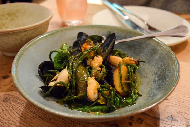 Mussels with Cascabel Oil, Hay Smoked Pink Fir Potatoes and Samphire at Rovi, Fitzrovia