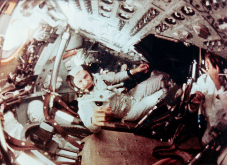 Still image from 16mm film of the crew taken while they were in orbit around the Moon; Frank Borman is in the center.