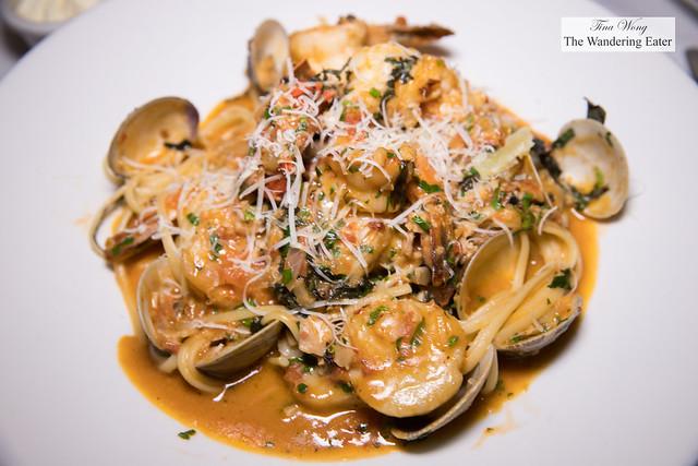 Seafood Pescatore - shrimp, scallops, clams, lobster, pomodoro sauce over linguine