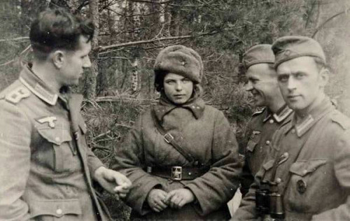 Three German soldiers with captured Red Army women soldier ,