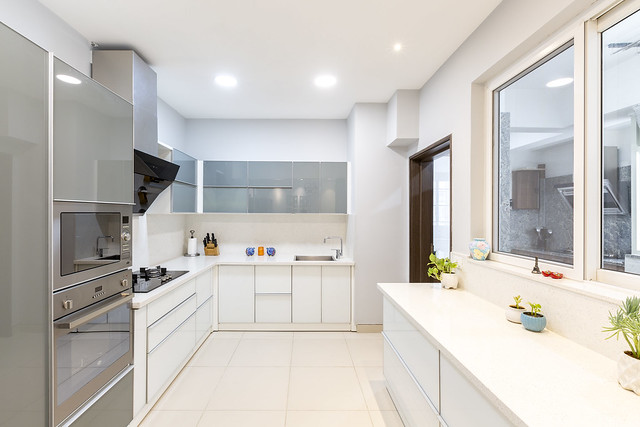 White kitchen interior design with cabinet pictures