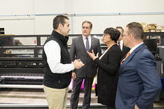 State Senator Rob Sampson, State Representative John Fusco and Representative Gale Mastrofrancesco listen during a business tour and announcement that Southington's SignPro facility is 100% solar powered.